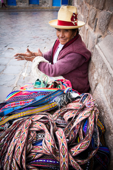 Peruvian woman spinning wool in Cuzco, Peru